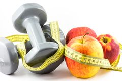 Apple, dumbbell and tape Stock Image
