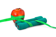 Apple and dumbbells Stock Photos