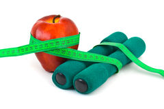 Apple and dumbbells Stock Images