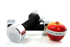 Apple and dumbels Royalty Free Stock Photo