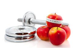 Apple and dumbels Royalty Free Stock Image