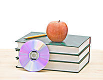 Apple, dvd, and books Stock Images