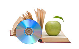 Apple, dvd, and books stock photography