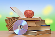 Apple, dvd, and books Stock Image