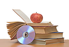 Apple, dvd, e livros Foto de Stock Royalty Free