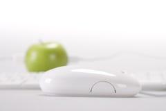 Apple e calcolatore Fotografia Stock