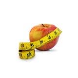 Apple e fita da medida fotos de stock