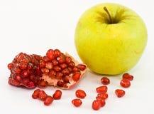 Apple e granuli di granato Fotografia Stock