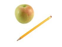 Apple e lápis Imagens de Stock Royalty Free
