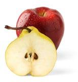 Apple e metade da pera Fotos de Stock