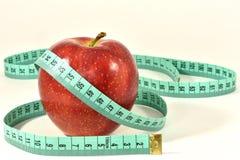 Apple e nastro di centimetro Immagine Stock Libera da Diritti