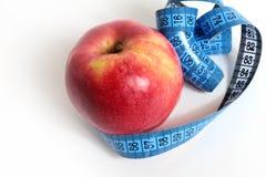 Apple e nastro di misura Fotografia Stock Libera da Diritti