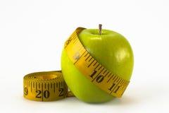 Apple e nastro di misurazione Immagini Stock Libere da Diritti
