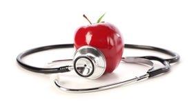 Apple e stetoscopio Fotografia Stock Libera da Diritti
