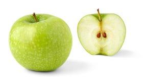 Apple e uma metade foto de stock