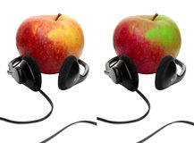 Apple with earphones Royalty Free Stock Photos