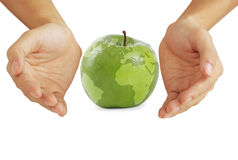 Apple earth. Apple and hands, isolated on white background Stock Photography