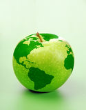 Apple Earth. Fresh green apple with world map Stock Photography