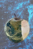 Apple earth bite. Apple earth with bite over the space blue background, save earth conceptual image- elements of this image are furnished by NASA Royalty Free Stock Photos