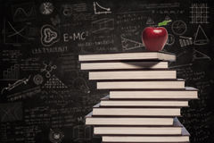 Apple and education books in class Royalty Free Stock Photos