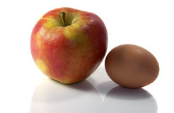 Apple and egg Stock Image