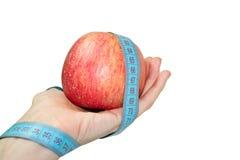 Apple in einer Hand Lizenzfreie Stockbilder