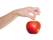 Apple in einer schönen weiblichen Hand Stockbild