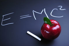 Apple and Einstein formula stock photography