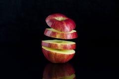 Apple em um fundo preto Fotografia de Stock Royalty Free
