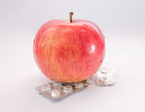 Apple with empty blister pill packs Stock Image