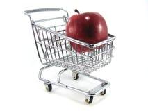 Apple en carro de compras Fotografía de archivo