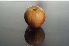Apple en el agua Imágenes de archivo libres de regalías