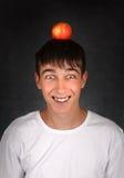 Apple en la cabeza Imagen de archivo libre de regalías