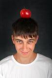 Apple en la cabeza Fotografía de archivo libre de regalías