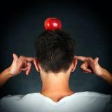 Apple en la cabeza Imagenes de archivo