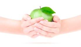 Apple en la mano Imágenes de archivo libres de regalías