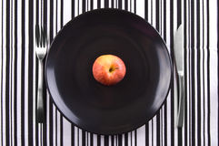 Apple en la placa Fotos de archivo libres de regalías