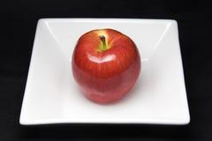 Apple en la placa imagen de archivo