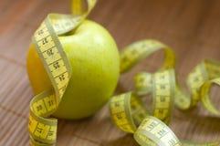 Apple en metrisch lint royalty-vrije stock fotografie