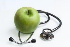 Apple en stetoskop stock foto's