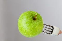 Apple en una fork Imágenes de archivo libres de regalías
