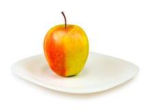 Apple en una placa Foto de archivo libre de regalías