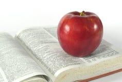 Apple et dictionnaire Image stock