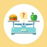 Apple et hamburger sur des échelles Images libres de droits