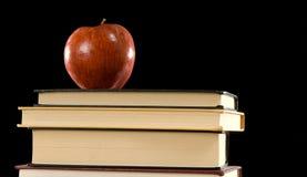 Apple et livres image libre de droits