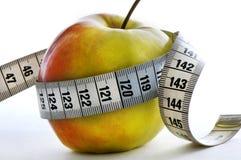 Apple et mètre Photo libre de droits