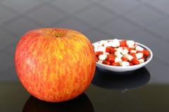 Apple et médicament Images libres de droits