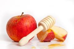 Apple et miel pendant année juive de Rosh Hashana la nouvelle Photos stock