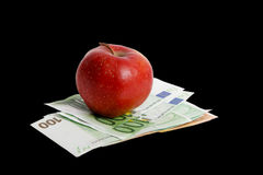 Apple on euro. Royalty Free Stock Photography