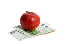 Apple on euro. Stock Photography